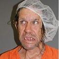 ヘアーキャップをかぶった男のマグショット(画像はnydailynews.comのスクリーンショット)