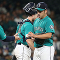 SEATTLE, WASHINGTON - SEPTEMBER 13: Yusei Kikuchi #18 hands the game ball over to Scott Servais #29 of the Seattle Mariners after giving up five runs in three innings against the Detroit Tigers during their game at T-Mobile Park on September 13, 2019 in Seattle, Washington. (Photo by Abbie Parr/Getty Images)
