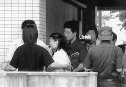 2002年6月、平井さん(仮名)が殺害されたマンションで行われた現場検証に立ち会った吉田被告(当時)