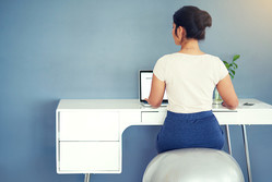 Rearview shot of a young businesswoman working on her laptop at homehttp://195.154.178.81/DATA/i_collage/pi/shoots/806156.jpg