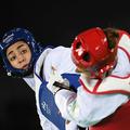 イランの女子選手初の五輪メダリストでありながら、同国を離れたことを発表したキミア・アリザデ(左、2016年8月18日撮影)。(c) Kirill KUDRYAVTSEV/ AFP