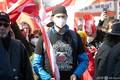 オーストリアの首都ウィーンで、新型コロナウイルス対策の制限措置に抗議するデモに参加する人々(2021年3月6日撮影)。(c)ALEX HALADA / AFP