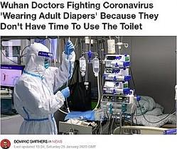 防護服姿で働く医療関係者(画像は『LADbible 2020年1月25日付「Wuhan Doctors Fighting Coronavirus 'Wearing Adult Diapers' Because They Don't Have Time To Use The Toilet」』のスクリーンショット)