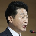 課長級協議の結果を発表する李浩鉉・貿易政策官=29日、ソウル(聯合ニュース)