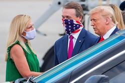 アメリカでは国を二分してマスク賛成派と反対派が論争を繰り広げている(EPA=時事)