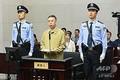 中国・天津市の第一中級人民法院で行われた裁判に出廷した孟宏偉氏(中央)。同法院提供(2019年6月20日撮影)。(c)AFP=時事/AFPBB News