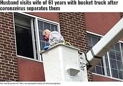 高所作業車を使って3階にいる妻と面会する男性(画像は『WMC Action News 5 2020年4月12日付「Husband visits wife of 61 years with bucket truck after coronavirus separates them」(Source: Nick Avtges/WFXT/Cox/CNN)』のスクリーンショット)