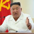 7日、朝鮮労働党中央委員会第7期第13回政治局会議に参加した金正恩氏(2020年6月8日付朝鮮中央通信)