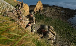U.S. Army Rangers dressed in the uniforms of U.S. Army Rangers from World War II scale the cliffs of La Pointe du Hoc in a re-enactment of the D-Day assault on June 05, 2019 near Cricqueville-en-Bessin, France. Sean Gallup/Getty Images
