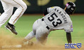 TOKYO, JAPAN - NOVEMBER 14: Infielder Jack Wilson #2 of Pittsburgh Pirates catches Norihiro Akahoshi of the Hanshin Tigers slides into second base during game 8 of the exhibition series between U.S. major league baseball and Japanese professional baseball at Tokyo Dome on November 14, 2004 in Tokyo, Japan. MLB won 5-0 in Game 8 to win the eigh-game exhibition series 5-3. (Photo by Koichi Kamoshida/Getty Images)