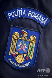 ルーマニア警察のロゴ(2011年12月5日撮影、資料写真)。(c)JOEL SAGET / AFP