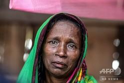 10年前にトラに夫を殺されたモサマット・ラシダさん。バングラデシュ・シャムナガールの自宅で(2019年11月11日撮影)。(c)Munir UZ ZAMAN / AFP
