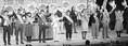 (写真)党と後援会の決起集会で激励に応える(左から)たつみコータロー参院議員、ますだ、村口、山根、上垣、玉井、柿原、塩見、竹村の各候補、石川氏=大阪府吹田市