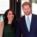 ヘンリー英王子(右)と妻メーガン妃=15日、ロンドン(AFP時事)