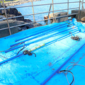 イルカ漁に使う金属の棒。ハンマーでたたいて音を出し、イルカを追い込む=2019年9月26日、静岡県伊東市富戸