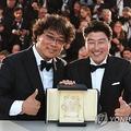 ポン・ジュノ監督(左)と主演俳優のソン・ガンホ=(聯合ニュース)