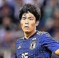 後半のアディショナルタイムで負傷しピッチを後にした冨安健洋。左の太腿裏を痛め、試合後に病院へ検査に向かったという。(C)SOCCER DIGEST