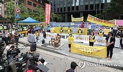 記者会見の形で行われた水曜集会=8日、ソウル(聯合ニュース)