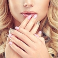 French manicure on nails. Luxury fashion style, manicure, cosmetics and makeup .