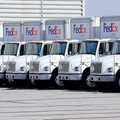 FedEx delivery trucks parked at a Federal Express facility