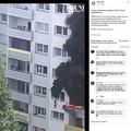 高さ10メートルの窓からぶら下がる子供(画像は『Q13 FOX 2020年7月22日付Facebook「2 boys saved when caught in falls in French apartment fire」』のスクリーンショット)