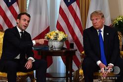 英ロンドンで会談するドナルド・トランプ米大統領(右)とエマニュエル・マクロン仏大統領(2019年12月3日撮影、資料写真)。(c)Nicholas Kamm / AFP