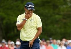 男子ゴルフ米国ツアーメジャー第2戦、第101回全米プロゴルフ選手権最終日。パットに臨む松山英樹(2019年5月19日撮影)。(c)Patrick Smith/Getty Images/AFP