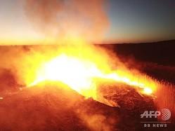ウクライナ・チェルノブイリ原発から半径30キロ圏内で広がる森林火災(2020年4月5日撮影)。(c)Yaroslav EMELIANENKO / AFP