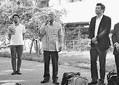 (写真)閉廷後の報告集会で訴える「求める会」の渡久山副代表(左から2人目)と金城代表(左端)=24日、那覇市