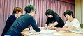 (写真)新聞労連の全国女性集会の分散会で、セクハラ被害の実態についてシートに書きだす参加者=21日、東京都内