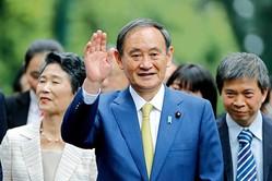 菅首相は安倍前首相と側用人の使い方がどう違うのか(写真/AFP=時事)