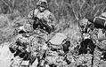 (写真)日米共同演習で演習場内に投入され、展開する米海兵隊員=2017年3月10日、群馬・相馬原演習場