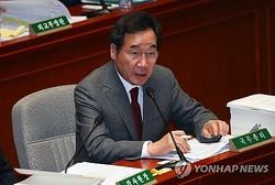 国会委員会で答弁する李氏=26日、ソウル(聯合ニュース)