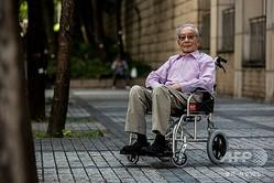 元共産主義者のラウ・マンシンさん。香港にて(2020年6月27日撮影)。(c)ISAAC LAWRENCE / AFP