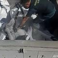 スペインの海外領メリリャで治安警察によって発見された、有毒廃棄物の袋の中に隠れていた移民(手前、2021年2月22日撮影)。(c)Handout / Spanish Guardia Civil / AFP