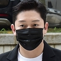 法廷に向かうチェ・ジョンボム被告(資料写真)=(聯合ニュース)