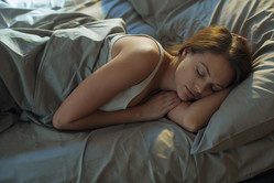 Close up of a woman sleeping on the bed